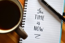 """Quote on notepaper """"THE TIME IS NOW"""""""